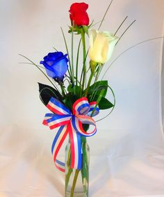 Red white and blue rose buds celebrate your freedom with this patriotic trio!  @Boyd's Flower Connection