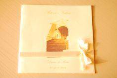 Copertina libretto del rito delle nozze con nome degli sposi, immagine del luogo in cui verrà celebrato, nome del luogo e data delle nozze