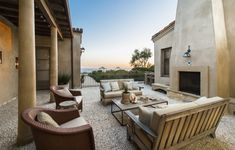 Alfresco Atmosphere  A courtyard is outfitted with outdoor seating and a fireplace