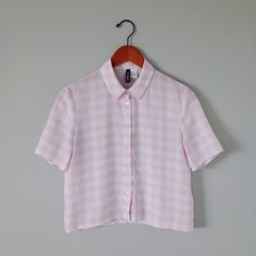 H&M Pink gingham top This top is so feminine and cute! It's semi sheer and just a tad cropped but not a crop top. The pattern is so cute. Would be really cute with a cardigan or under a sweater with the collar peeking out this winter. Perfect condition. Never been worn. H&M Tops Blouses