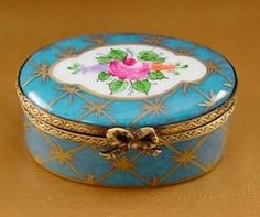 Oval blue Limoges box with gold accents and flowers