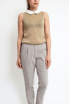 This shimmery sleeveless beige top with white collar will make you look fashionable for every occasion. Wear yours with a simple skirt for an instantly party-ready ensemble. From Sienna With Love.        Available at Sienna & Faye.