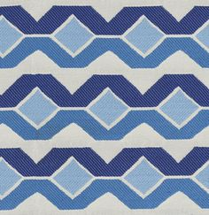 Twisted Chain Fabric A woven fabric with a geometric chain style stripe in denim, indigo and powder blue.