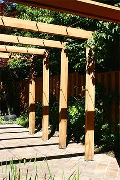 "Contemporary Pergola - This very simple, contemporary pergola incorporates 3/8"" stainless rods and stout 6 x 6 posts and beams. The stainless rods were machined to create a very simple unobtrusive connection to the large beams. http://www.trellisstructures.com/pergolas/ctp07-contemporary-pergola.html"