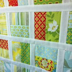 "I'd definitely ""Moda'fy"" this and use charm packs and a bella solid jelly roll. Wham-bam-easy-quilt!!!"