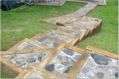 Stone walkway and stair system retained by timber frame.