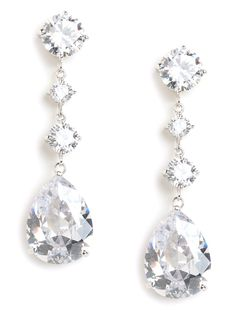 Channel your inner fairytale princess in these dazzling drop earrings, which feature a glorious cascade of faceted diamond-like gems. They're brilliantly cut and faceted to perfection — and elegantly extravagant, too. Wedding Jewelry, Jewelry Box, Jewelry Accessories, Fine Jewelry, Unique Jewelry, Bride Accessories, Jewellery, Fashion Necklace, Fashion Jewelry