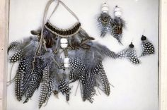 Guinea hen feathers and white beads form earthy earrings and neckpiece