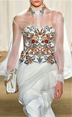 Marchesa, 2013/2014...Here's a great idea to having sleeves in a wedding dress. Change the fabric to fit your style but keep the details. Ask your seamstress for ideas.