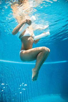 Float in deep water with noodle wrapped around upper back and under arms, hands on either end. Extend legs toward pool bottom, feet together, toes pointed. Engage abs and raise knees toward chest (as shown). Hold for two seconds, then straighten legs for one rep. Do 20 reps. works abs, hips, legs