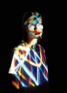 Light is projected onto models in this photographic project by Mads Perch using understated portraiture covered in vivid coloured light.
