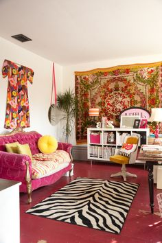 Brad and Jude's house// bright and retro living room with textile on wall