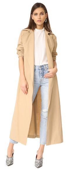 maude trench coat by Ulla Johnson. A midi-length Ulla Johnson trench coat in a draped style. An optional self-belt cinches the open placket, and a long ...