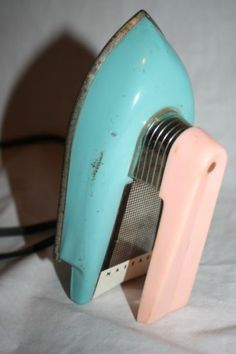 Vintage working toy clothes iron Nassau teal & pink.  From the 1950's or 1960's.