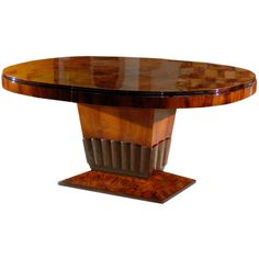 Art Deco Oval Dining Table with Tulip Base | From a unique collection of antique and modern dining room tables at http://www.1stdibs.com/tables/dining-room-tables/