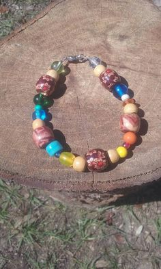Hey, I found this really awesome Etsy listing at https://www.etsy.com/listing/518673034/boho-hippy-bracelet-glass-and-wood-beads