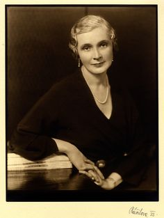 Black and white photograph of Mrs. J. Willis Slaughter wearing a dark dress and pearl necklace, 1932