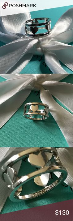 Tiffany & Co. Retired Wide Hearts Ring This ring is in excellent condition considering the age. This is a retired piece and very hard to find. There are minor scratches from daily use. Comes with a pouch only. Please look at the photos closely. Bundle with the matching necklace! Make me a reasonable offer and thanks for stopping by! Tiffany & Co. Jewelry Rings