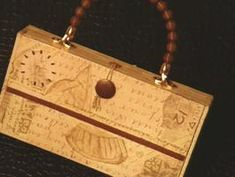 How to Make a Cigar Box Purse    Transform an old cigar box into a stylish purse with these simple instructions.