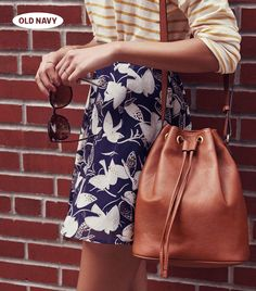 Drawstring bucket bag + floral mini skirt + striped shirt = A+ fall outfit