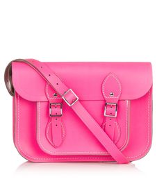 """CAMBRIDGE SATCHEL  The Fluoro Satchel (11"""")    Handmade in the UK, the Fluoro satchel features an adjustable shoulder strap and traditional buckle closures. Perfect for school, this eye-catching pink shoulder bag boasts a roomy interior and a handy slip pocket."""