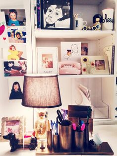 a glimpse at ioanna's desk: a vintage pineapple lamp, old photographs of her mom and dad, and presents from loved ones. (kate spade new york home)