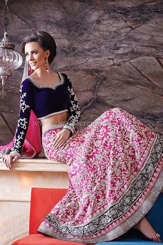 Reception Outfits - Vintage style asian wedding outfit with a long sleeves purple velvet blouse and a heavily embroidered pink raw silk lengha