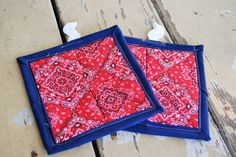 Fabric Hot Pads // Quilted Pot Holders // Red Bandanna Print with Navy Border on Kitchen Pot Holders - Set of Two by QuirkyQuiltress on Etsy https://www.etsy.com/listing/248499381/fabric-hot-pads-quilted-pot-holders-red