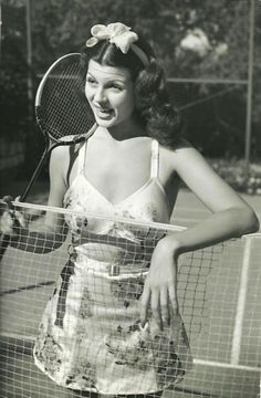 Rita Hayworth, c. 1939 tennis outfit sports wear 30s 40s war era wwII play suit playsuit novelty print satin 2 piece fashion style pin up girl photo print ad model movie star