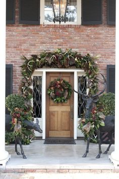 Beautiful Christmas door! One day, when we have a big pretty house.