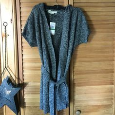 Michael Kors sweater w/hood Large NWTS Bought and she never wore it. Tags attached at $99. No trades. Size L belt around waist short sleeve amazing.  MICHAEL Michael Kors Sweaters Shrugs & Ponchos