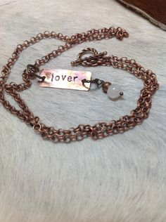 A personal favorite from my Etsy shop https://www.etsy.com/listing/213707140/lover-stamped-copper-necklace-with