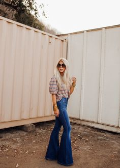 Lisa Allen of salty lashes wearing l'agence flare jeans with a free people stripe top Summer Outfits Women, Mom Outfits, Chic Outfits, Fall Outfits, Fashion Outfits, Curvy Girl Fashion, 70s Fashion, Winter Fashion, Free People Sale
