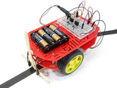 "In the ""Build a Self-Driving Robot that Can Automatically Follow a Line"" #science project, students use a two-wheeled robot chassis and breadboard to build a robot that uses an infrared light sensor to follow a dark line. [Source: Science Buddies; http://www.sciencebuddies.org/science-fair-projects/project_ideas/Robotics_p023.shtml?from=Pinterest] #STEM #robotics #engineering #scienceproject"