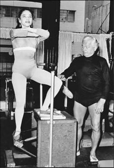 An archival image of Joseph #Pilates teaching 1st generation student Eve Gentry on the Wunda Chair.