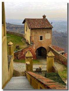 Climbing down from the castle in Cisterna d'Asti, Langhe wine zone in Piemonte, Italy Cuneo