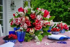 My blood pressure rose with this arrangements--the tulips with the tablecloth..I might have chosen just to go with red and white, skip the blue on the table.