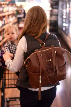 Lily Jade Shaylee Diaper Bag Review | leather diaper bag tote, crossbody, or backpack | removable diaper bag insert | gold hardware | brown cognac leather