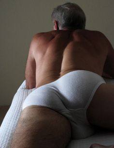 Onbed Man peeing