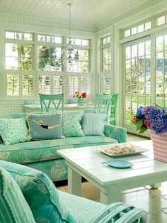 I think this may be the 15th time I've pinned this Coastal-Cool Cottage Style decor pic, but I just love the windows, table, chairs, coffee table, etc.