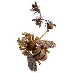 ;Double Bee diamonds, tiger eye and enamel.