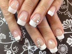 White acrylic nails with Swarovski crystal nail art