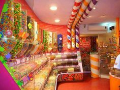Candy Shop! Id use PVC tubes covered with ribbon to make these!! Outside the candy shop they would really stand out.