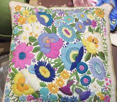 Linen throw pillow with colorful floral crewel embroidery. SOLD to a friend - $10.00!