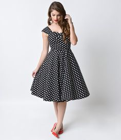 The vintage dress inspired cut of the Darlene Polka Dot Swing Dress from Collectif makes this a must have frock for any vintage gals wardrobe! This swingin' style features comfy yet stylish widely cut straps, a beautiful sweetheart neckline and a wonderfu