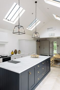 It's hard to imagine this kitchen is in an amazingly pretty Victorian family home in the Hertfordshire countryside, it almost looks as if it could be in LA, with its cool feel and rustic styling. Pantry Blue and Damask deVOL Shaker cupboards, marble worktops and pale parquet flooring