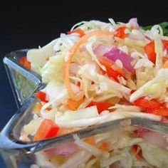 Angie's Dad's Best Slaw An absolutely delicious coleslaw, more tart and tangy than the creamy kind. It keeps well and can be made ahead of time. Summer Slaw, Coleslaw Dressing, Vegetarian Cabbage, Cooking Recipes, Healthy Recipes, What's Cooking, Easy Recipes, Dinner Recipes, Side Dishes Easy