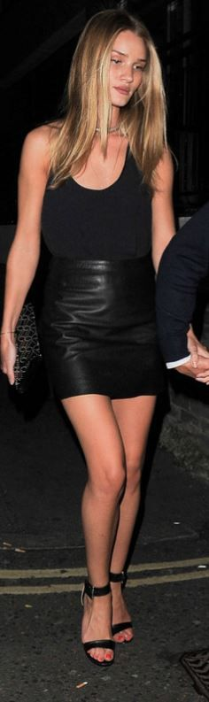 Who made  Rosie Huntington-Whiteley's black leather skirt, jewelry, clutch handbag, and ankle sandals?
