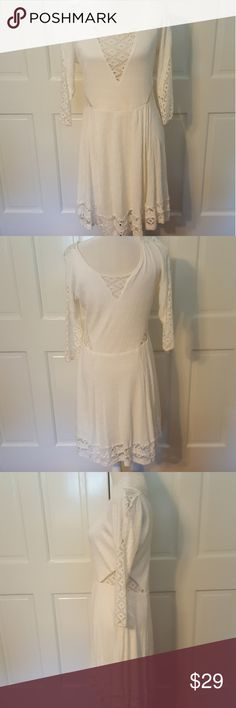 Free People Dress Pre loved whimsical Free People ivory dress. SHELL 97% rayon,  2% polyester, 1% spandex.   3/4 decorative cutout lace sleeves.  EUC. Free People Dresses