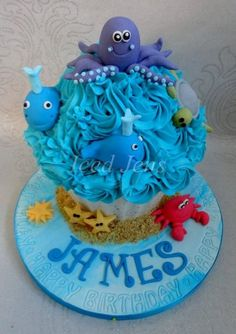 My first cake to upload :-) Under the Sea themed Giant Cupcake Giant Cupcake Mould, Large Cupcake Cakes, Cupcake Torte, Big Cupcake, Giant Cupcakes, Small Cake, Fancy Cakes, Sea Cakes, First Birthday Cakes